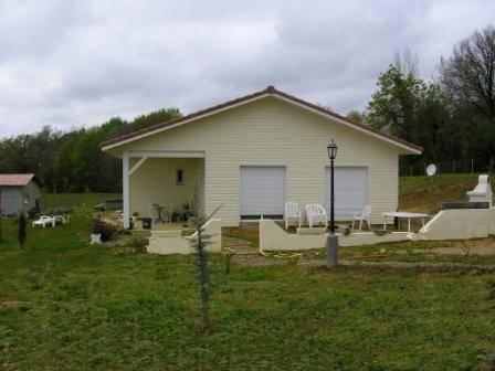 Maison ossature bois avec abris voiture et abris camping for Prix maison ossature bois hors d eau hors d air